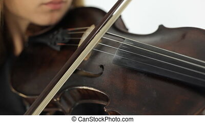 Girl playing the violin with inspiration