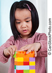 Girl playing toy blocks