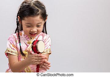Girl Playing Toy Drum