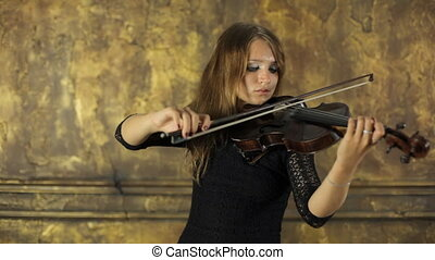 Girl playing violin on vintage background