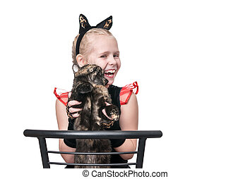 Girl playing with a cat