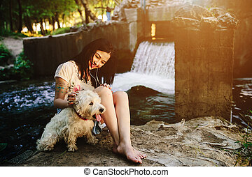 girl playing with a dog