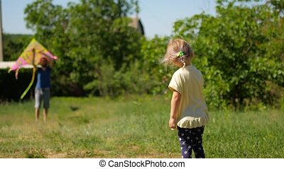 girl playing with a kite in beautiful gardens