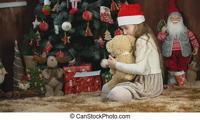 girl playing with a teddy bear