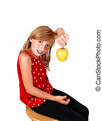 Girl playing with an apple.