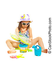 Girl playing with beach toys