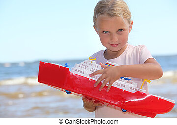 Girl playing with boat