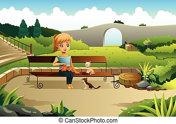 Girl Playing with Cats