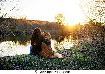 Girl playing with Caucasian shepherd dog, autumn - Young...
