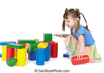 Girl playing with color toys