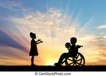 Girl playing with disabled boy with ball on sunset