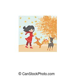 girl playing with his dogs in autumn