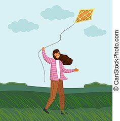 Girl playing with kite in windy weather on green plain. Strong wind, cloudy. Girl launches a kite