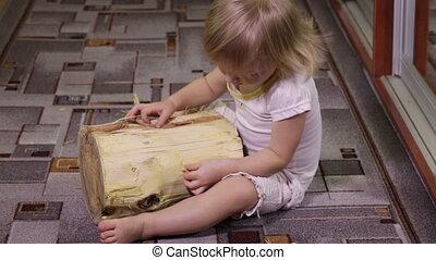 Girl playing with log