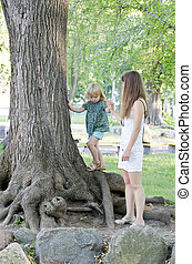 Girl playing with mother in the park