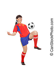 girl playing with soccer ball in studio