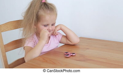Girl playing with spinner