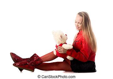 Girl playing with stuffed animal