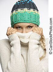 girl playing with sweater and looking in camera