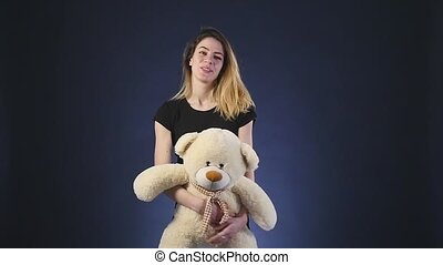 girl playing with teddy bear - Isolated on black slowmotion