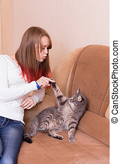 girl playing with the cat
