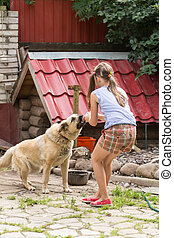 girl playing with the dog