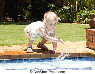 Girl playing with the water