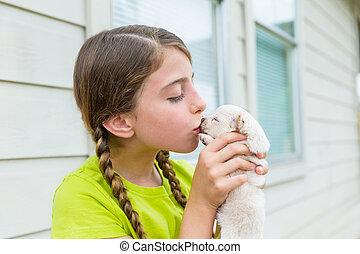 Girl playingkissing puppy chihuahua pet dog