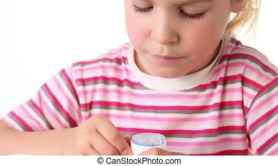 Girl plays game where she need to roll spherule through...