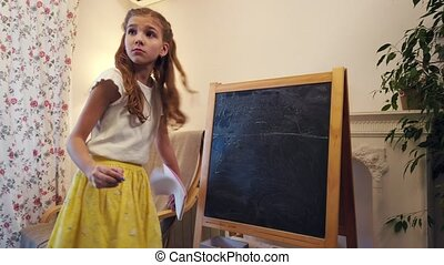 Girl plays school at home - Girl playing school at home