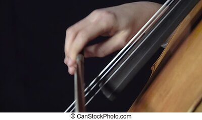Girl plays the cello professionally lyrical music. Black...