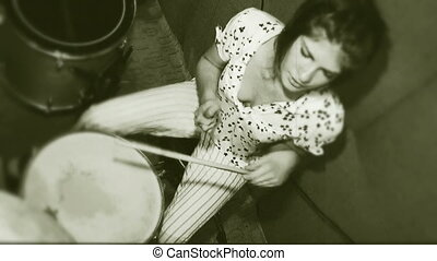 Girl plays the drums - Beautiful young girl who is actively...