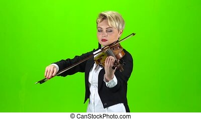 Girl plays the violin composition. Green screen - Girl plays...