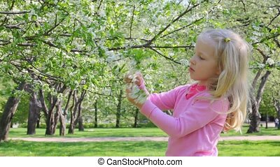 Girl plays with flower tree