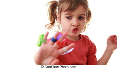 little cute girl plays with laser flashlights of different colors on fingers depicting his hand flying spacecraft, white background