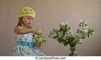 Girl plucking and flinging flowers