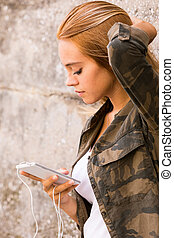 girl plugged into her mobile phone