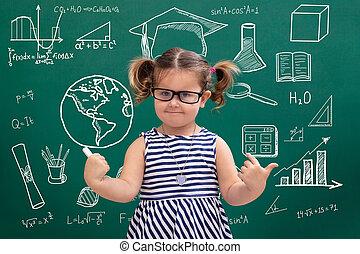 Girl Pointing Educational Symbols On Green Chalkboard