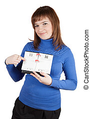 Girl pointing to date in diary