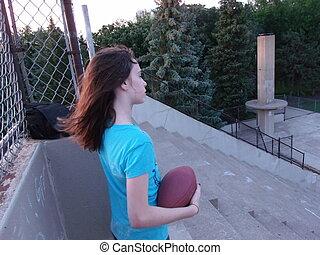Girl Pondering Football