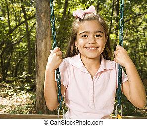 Girl portrait on swing.