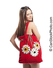 Girl portrait with red beach bag isolated
