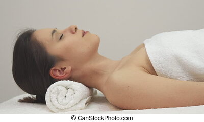 Girl poses on the massage table