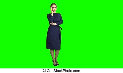 Girl posing and adjusting glasses. Green screen - Girl in a...