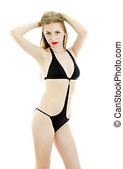 Girl posing in black swimsuit. Isolated on white.