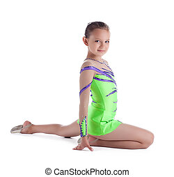 Girl posing in green - young gymnast isolated
