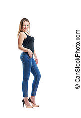 Girl posing in jeans in front of the camera