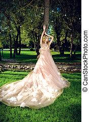 girl posing in lush dress