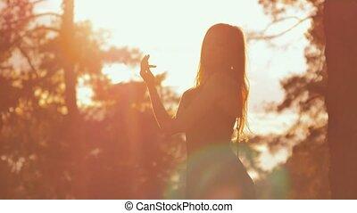 girl posing in sun backlit - beautiful girl with long hair...