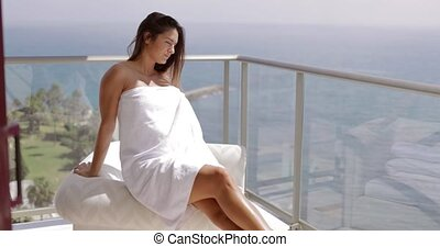 Girl posing on hotel terrace - Young sensual brunette...